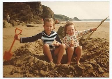 Pip with her big sister (who you'll meet in Squishy McFluff book 6 as Auntie Tash!) in their sand boat!