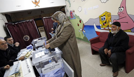 A woman casts her ballot inside a polling station during municipal elections in Istanbul